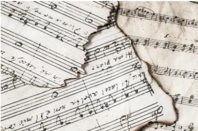 Blandede noder med musik. Musik sætter ro på vores hjerner og får os til at slappe af.
